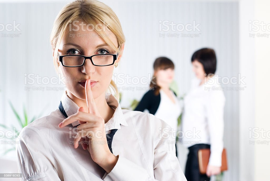 Attractive woman with sign 'keep silence' stock photo