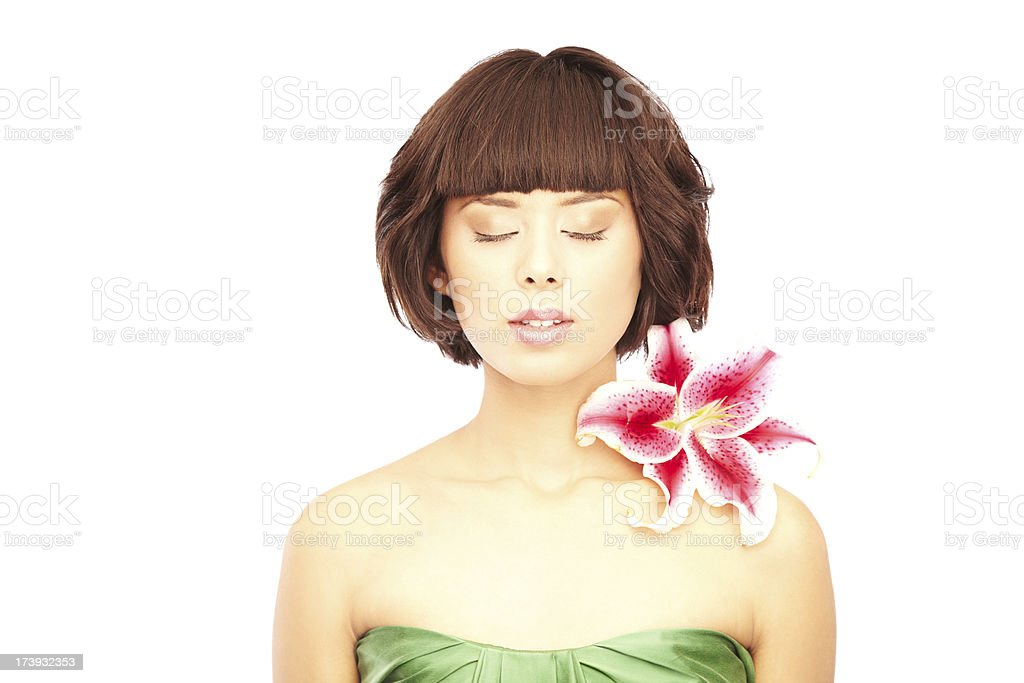 Attractive Woman with Stargazer Lily on her shoulder. Eyes Closed royalty-free stock photo