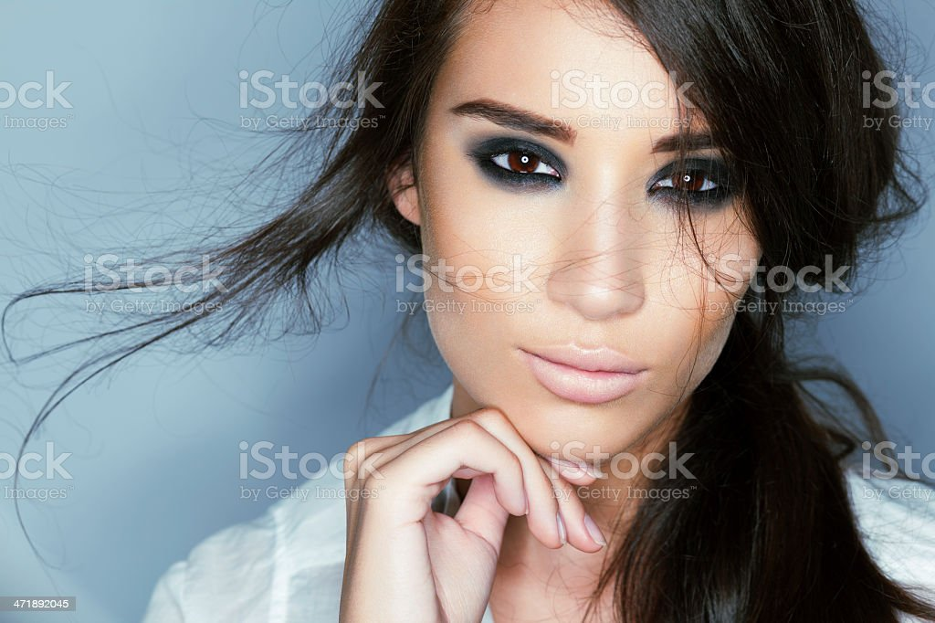Attractive woman with striking eyes and flowing dark hair stock photo