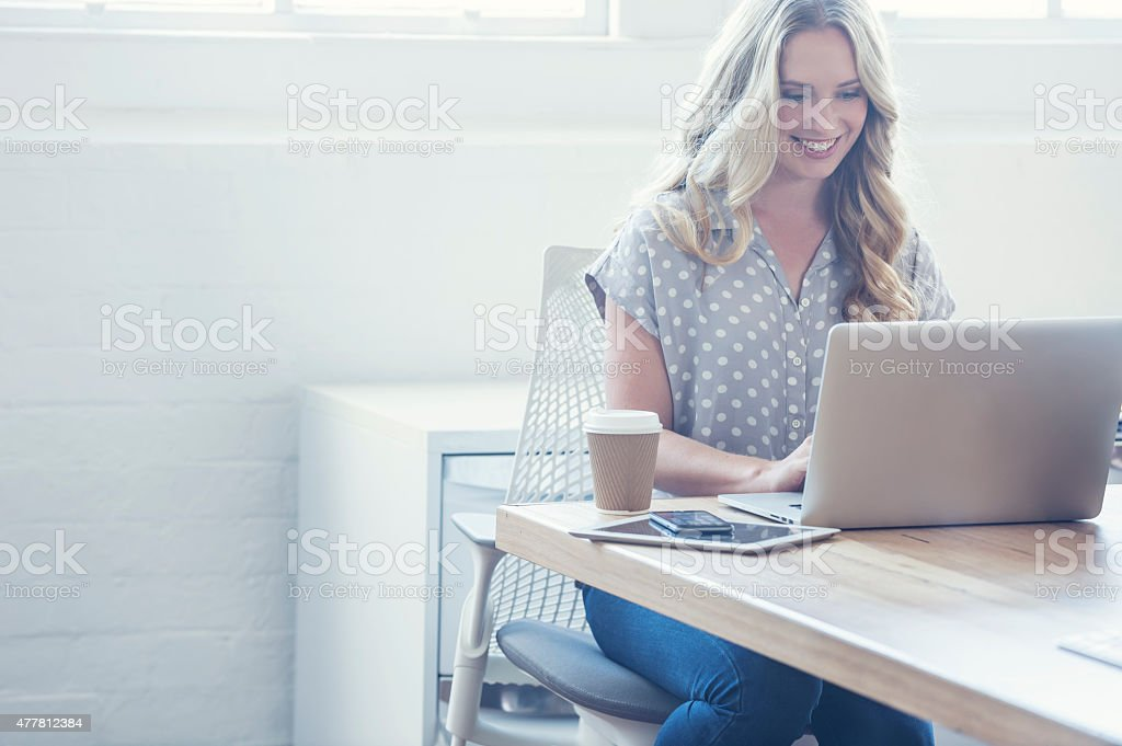 Attractive woman working on a laptop computer. stock photo