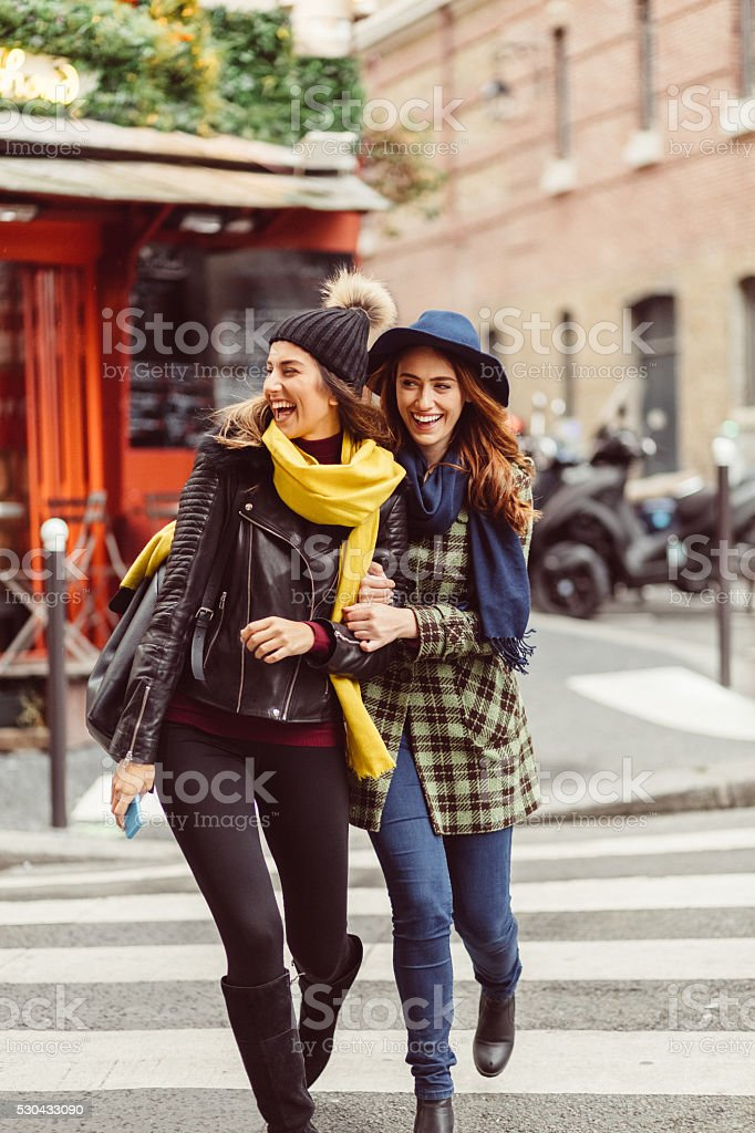 Attractive women crossing the street in Paris stock photo