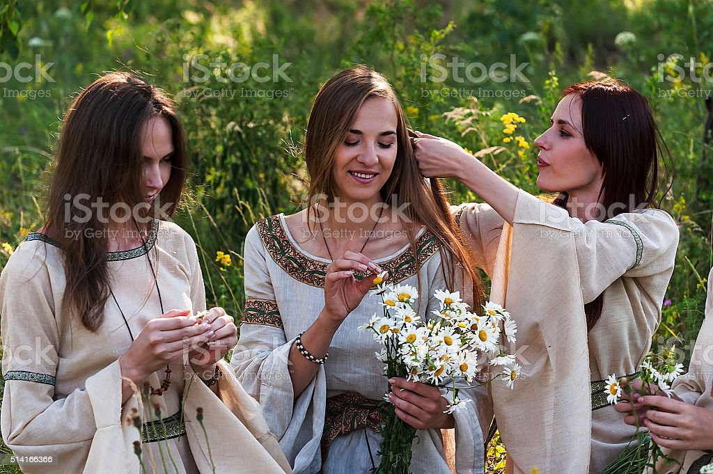 Attractive women relaxing on nature stock photo