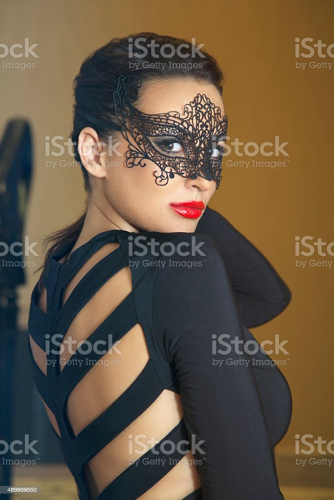 Attractive women with lace mask stock photo