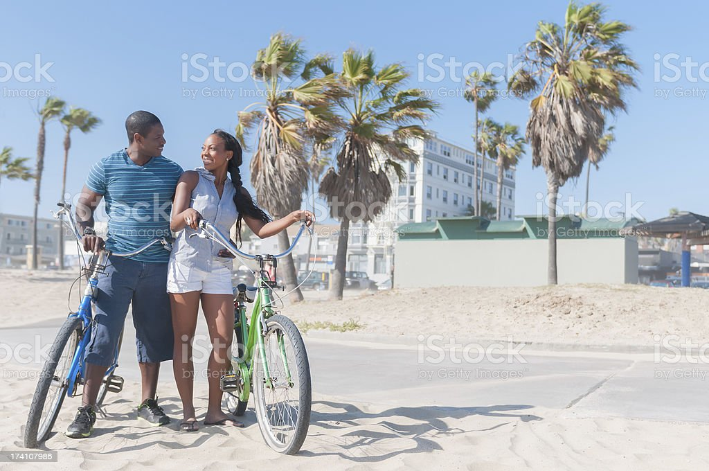 Attractive Young African American Couple with Cruiser Bikes royalty-free stock photo
