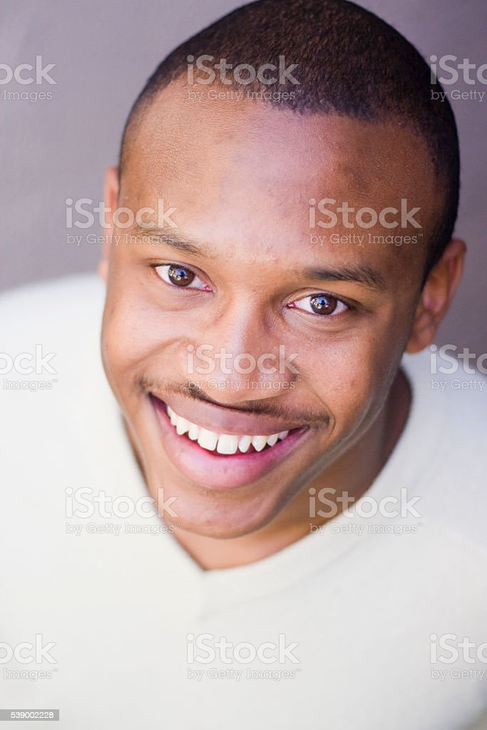 Attractive Young African American Man Looking at Camera stock photo