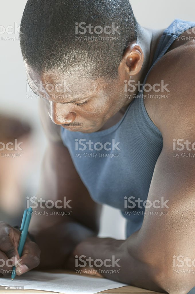 Attractive, Young African American Man Writing royalty-free stock photo