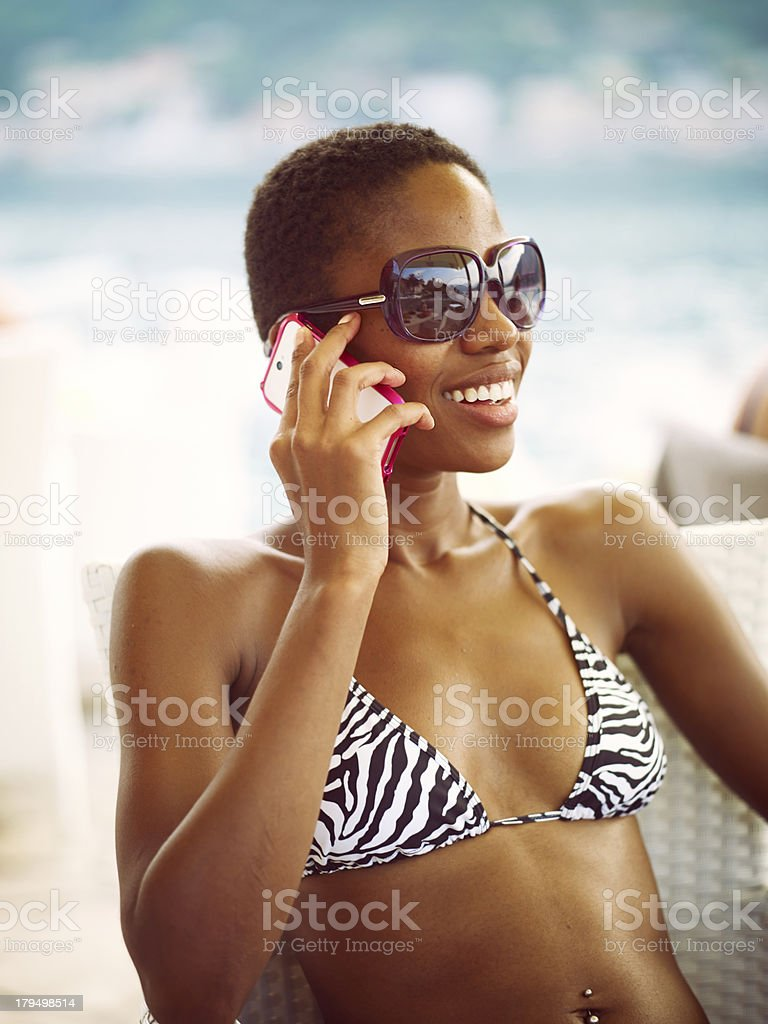 Attractive Young African Woman with smartphone royalty-free stock photo