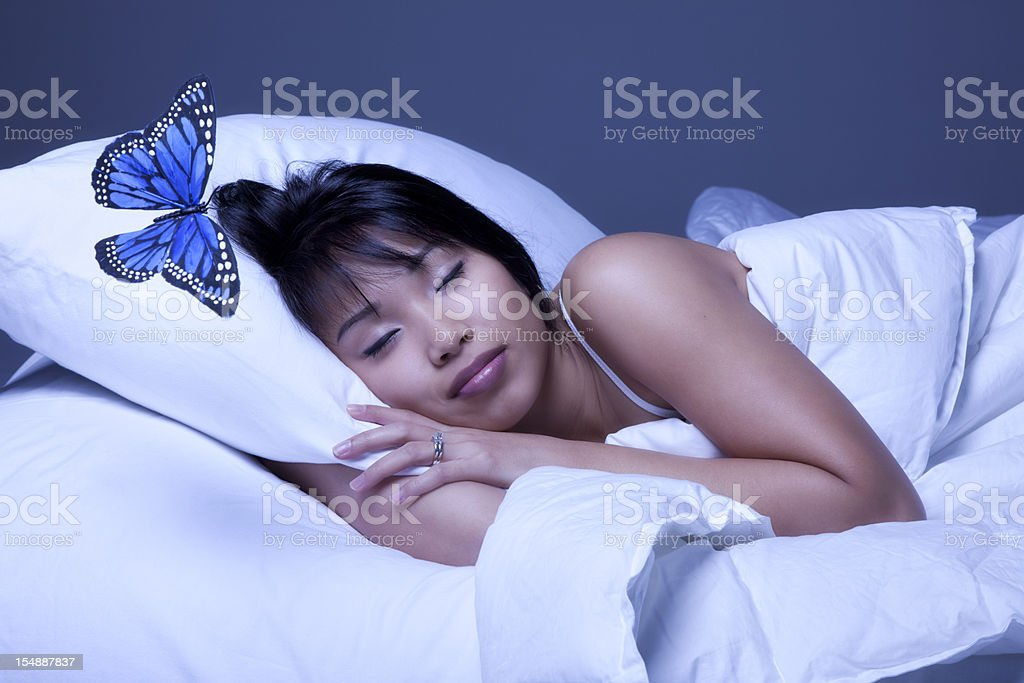 Attractive Young Asian Woman Asleep with Blue Butterfly royalty-free stock photo