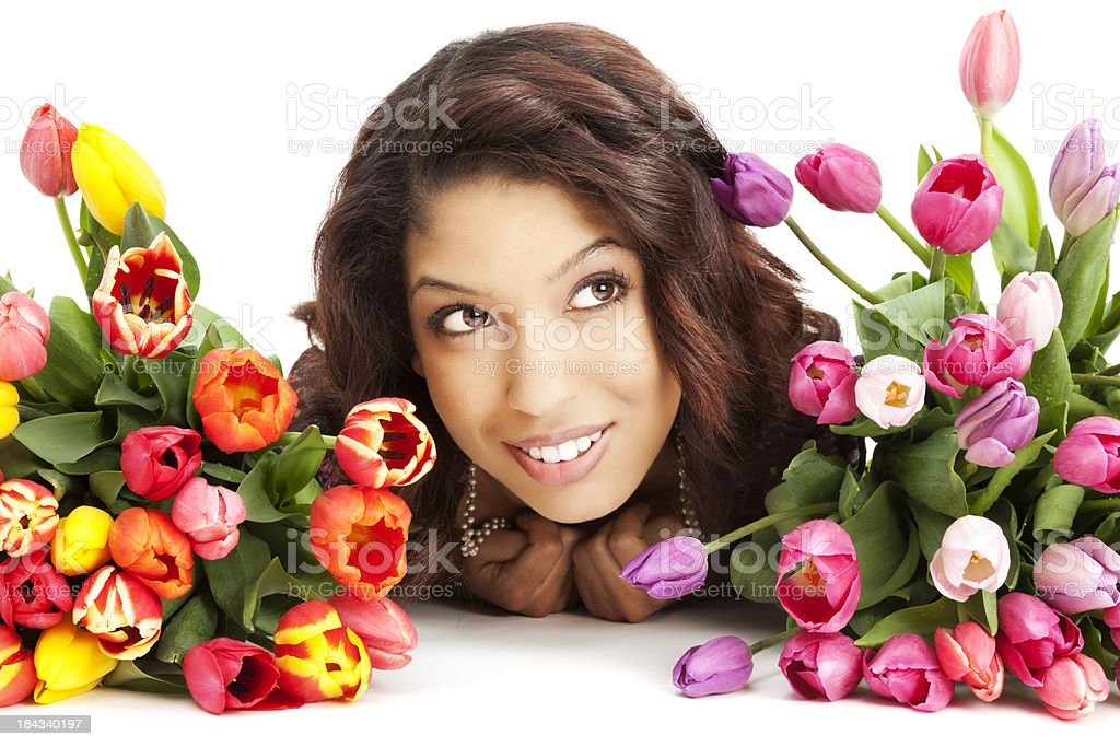 Attractive Young Asian Woman Lying Among Tulips royalty-free stock photo