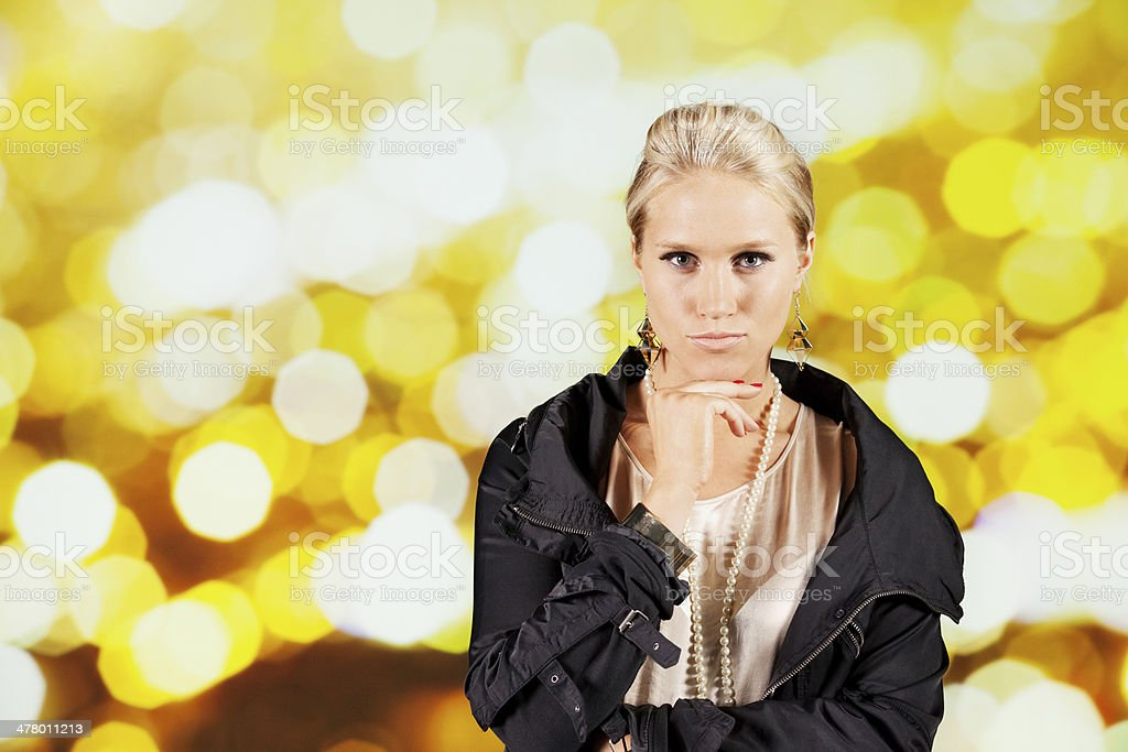 Attractive young beautiful woman with hand on chin royalty-free stock photo