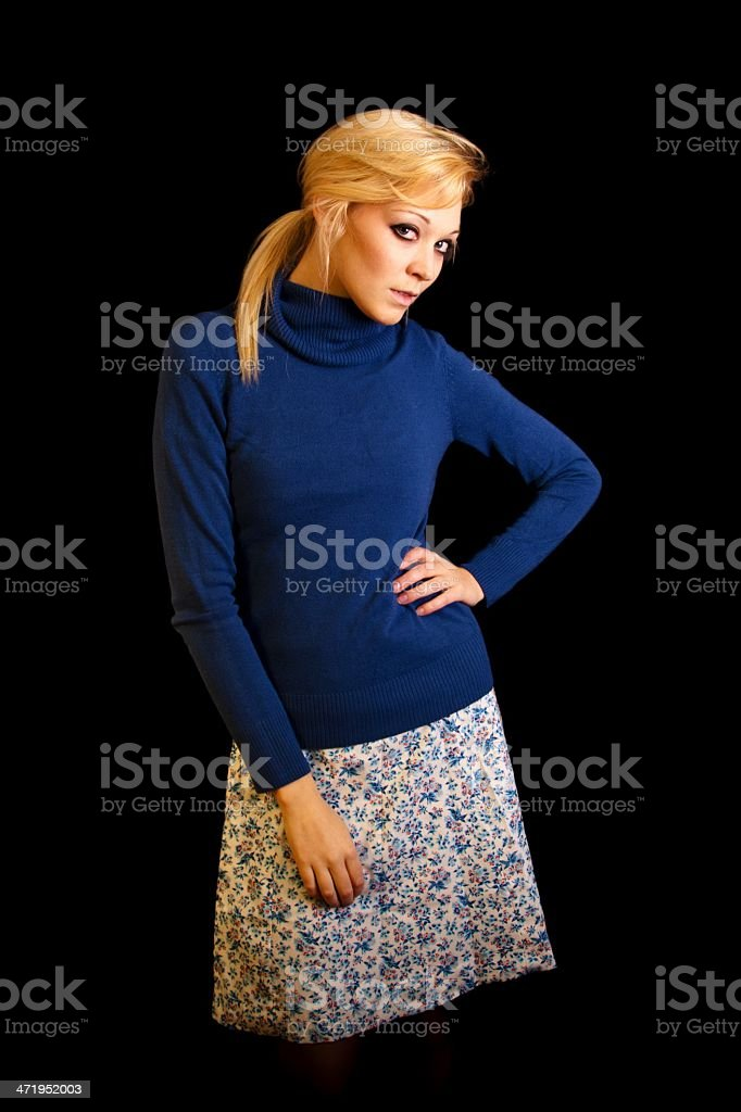 Attractive young blond women with blue turtleneck stock photo