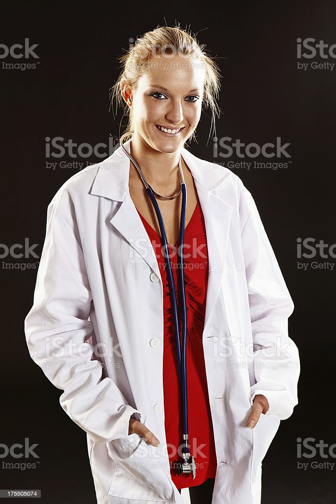 Attractive young blonde medical professional in lab coat with stethoscope stock photo