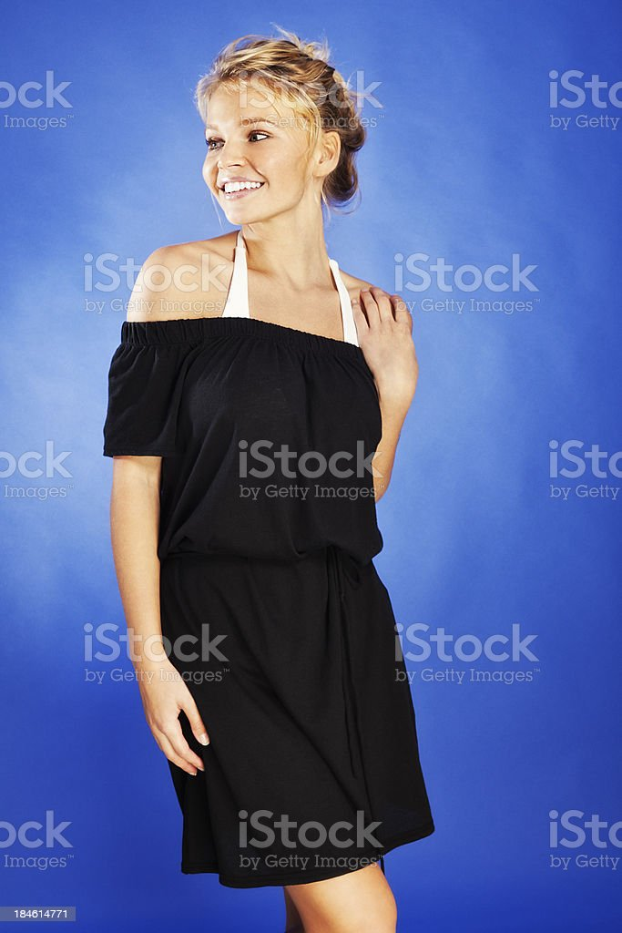 Attractive Young Blonde Woman in Black Beach Cover-up stock photo
