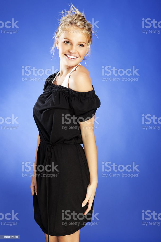 Attractive Young Blonde Woman in Black Beach Cover-up royalty-free stock photo