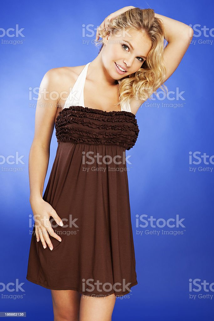 Attractive Young Blonde Woman in Brown Beach Cover-up stock photo