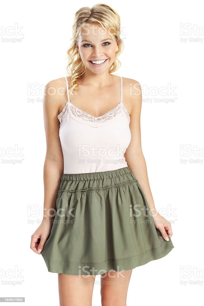 Attractive Young Blonde Woman in Green Skirt royalty-free stock photo