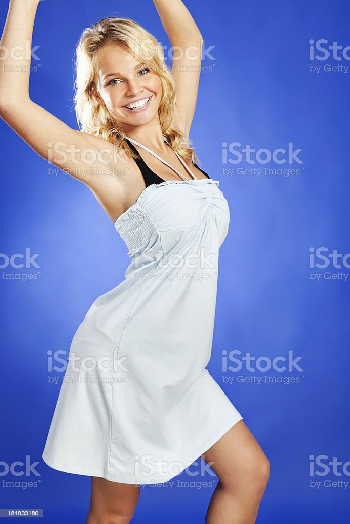 Attractive Young Blonde Woman in Light Blue Beach Cover-up stock photo