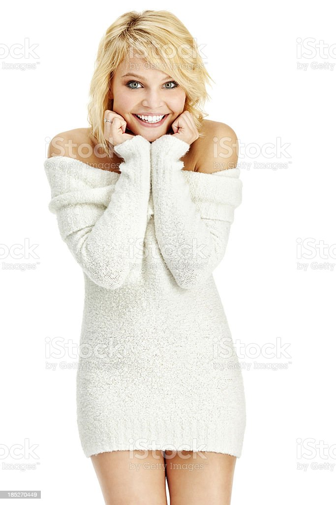 Attractive Young Blonde Woman in Short White Sweater Dress stock photo