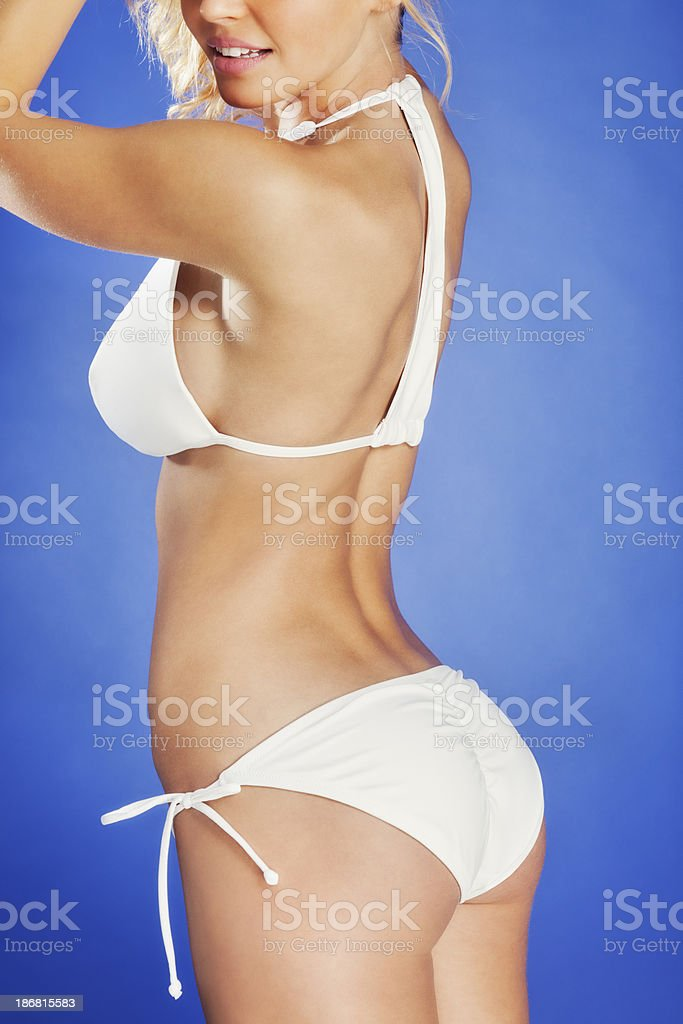 Attractive Young Blonde Woman in White T-back Bikini royalty-free stock photo