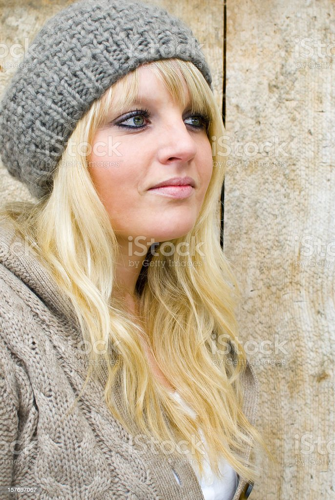 Attractive young blonde woman with gray wool cap royalty-free stock photo