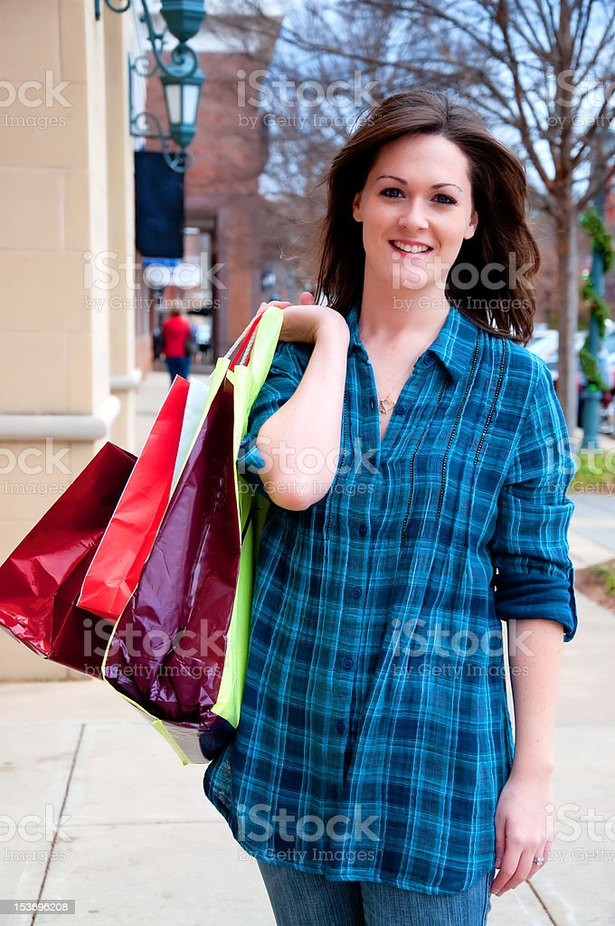Attractive Young Brunette on Shopping Spree stock photo