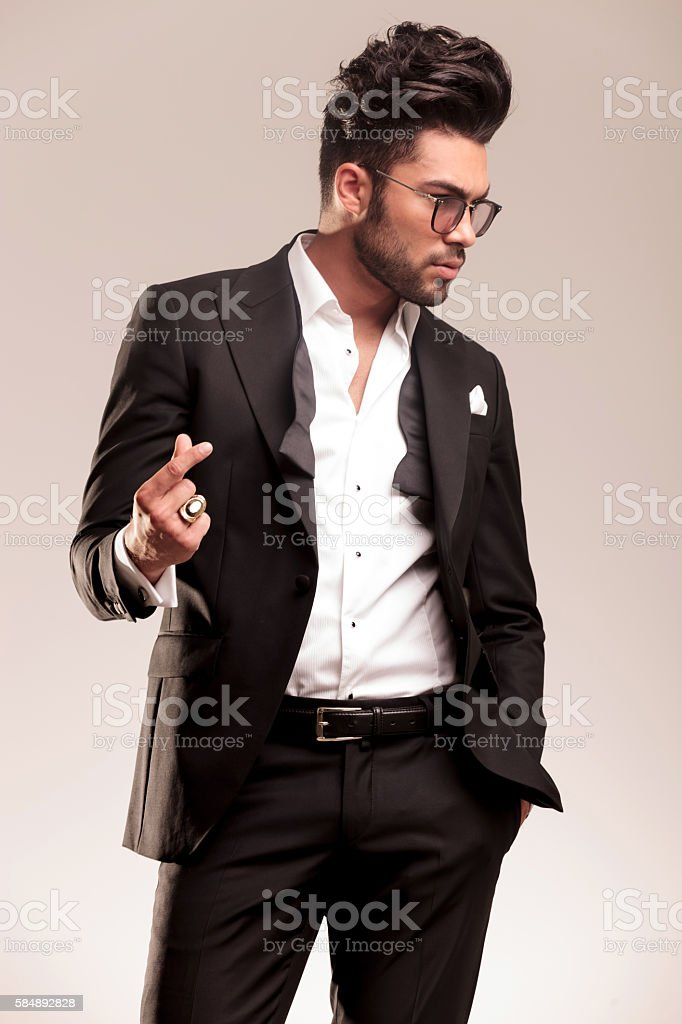 attractive young business man snapping his fingers stock photo