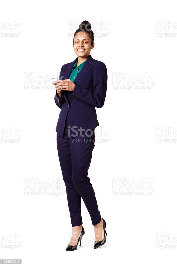 Attractive young business woman with a cell phone stock photo