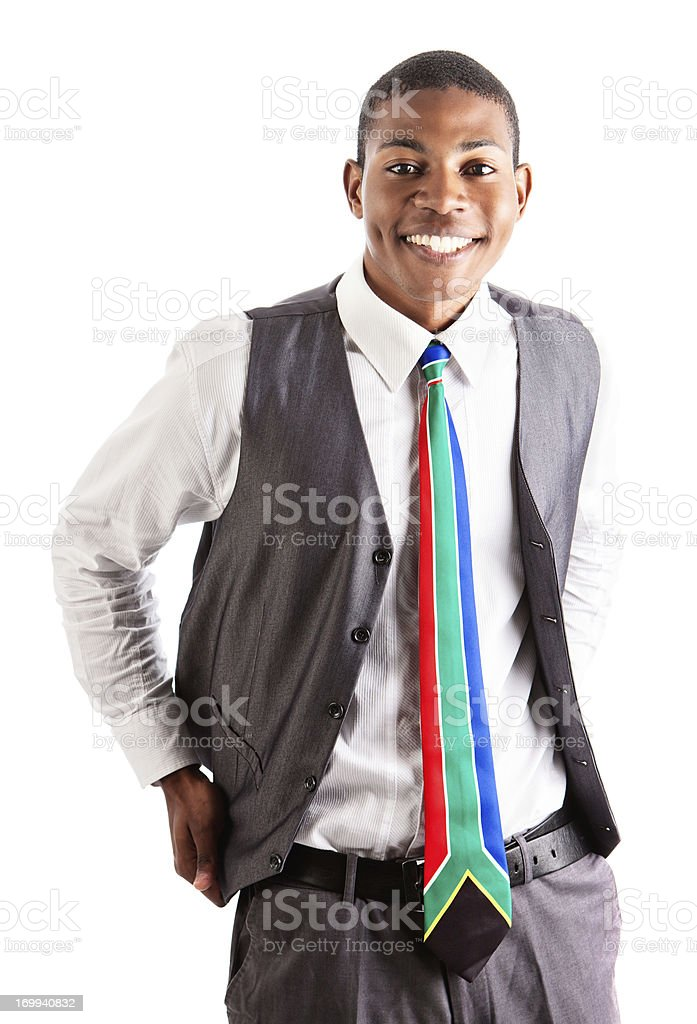 Attractive young businessman with cheeky grin looks keen royalty-free stock photo