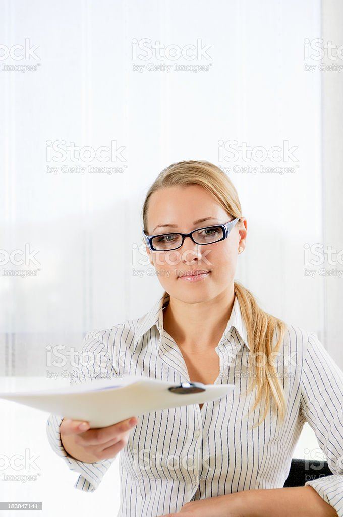 Attractive young businesswoman giving a dossier stock photo