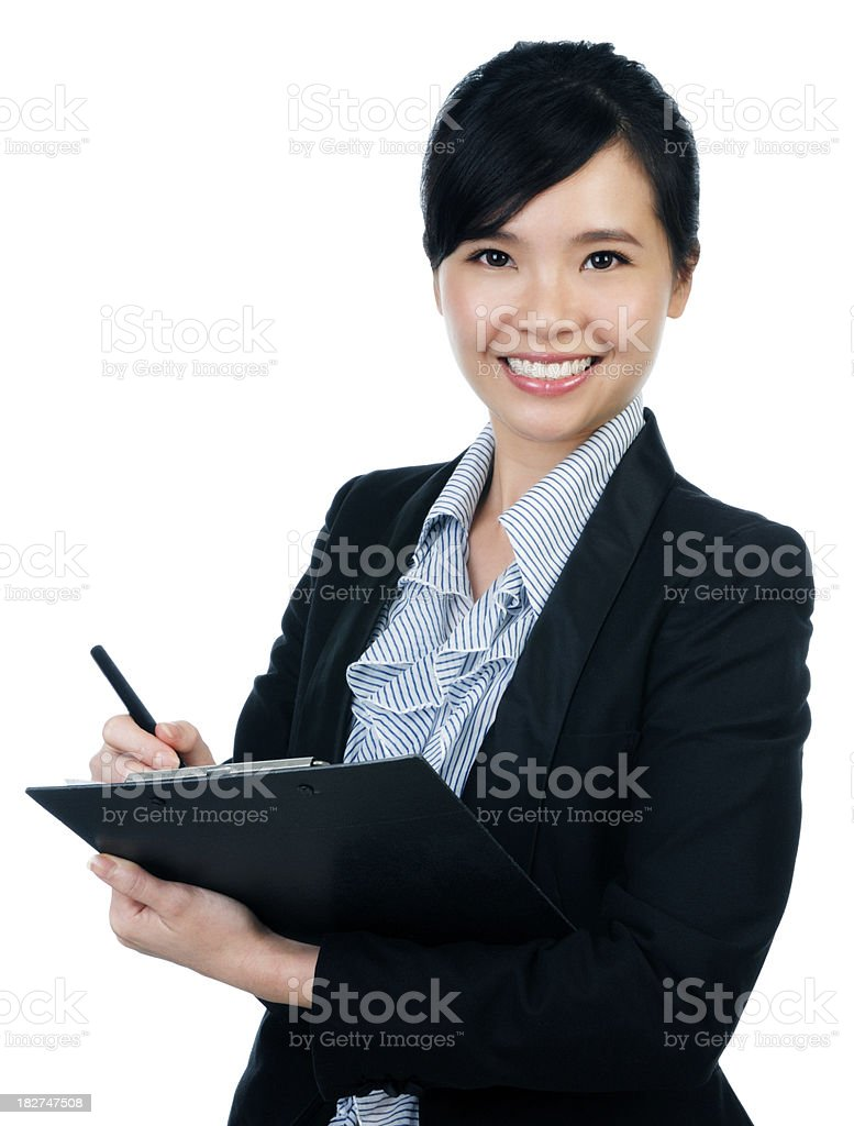 Attractive young businesswoman holding a file stock photo