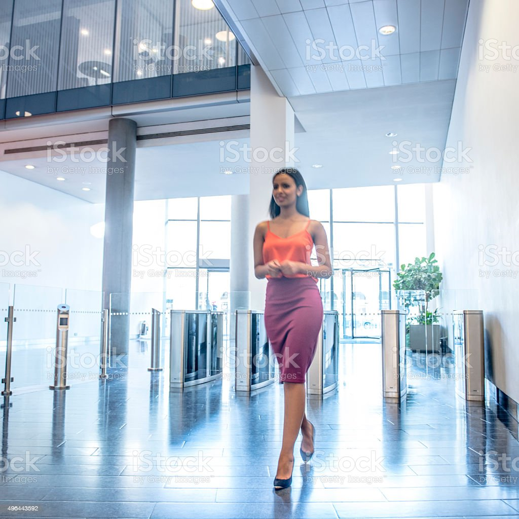 Attractive young businesswoman in modern office foyer stock photo