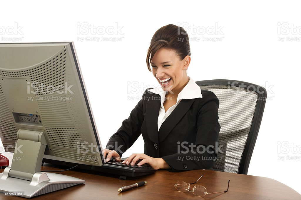 Attractive Young Businesswoman Laughing at Her Desk royalty-free stock photo