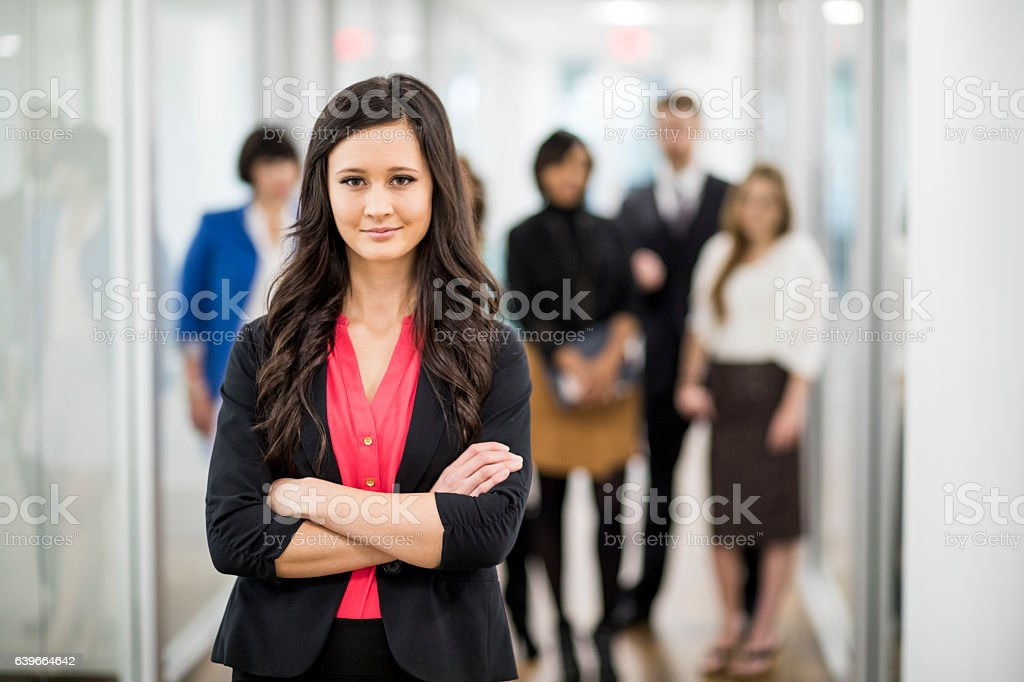 Attractive Young Businesswoman Leading Her Team stock photo