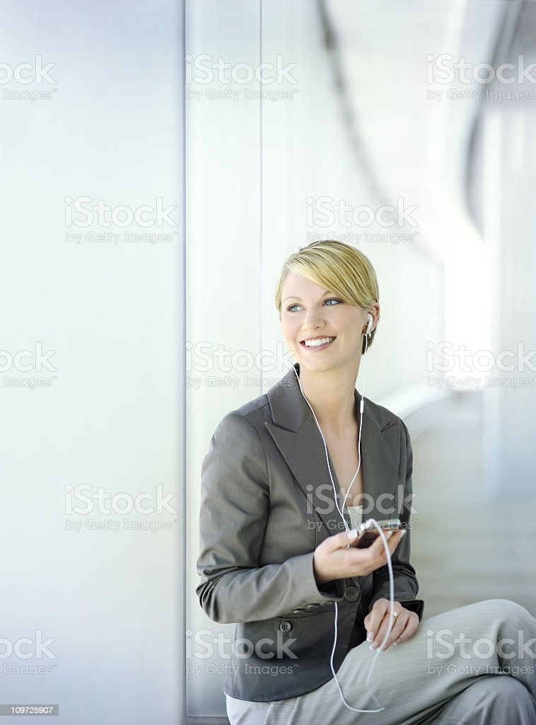 attractive young businesswoman relaxing royalty-free stock photo