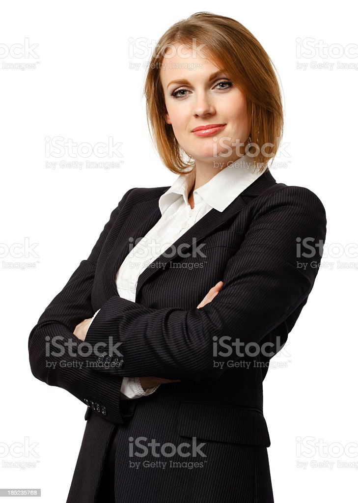 Attractive young businesswoman with her arms crossed royalty-free stock photo