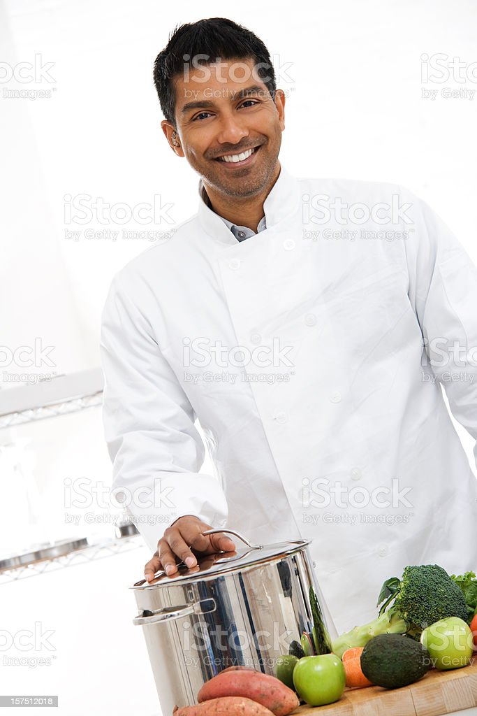 Attractive Young Chef with Arms Crossed royalty-free stock photo