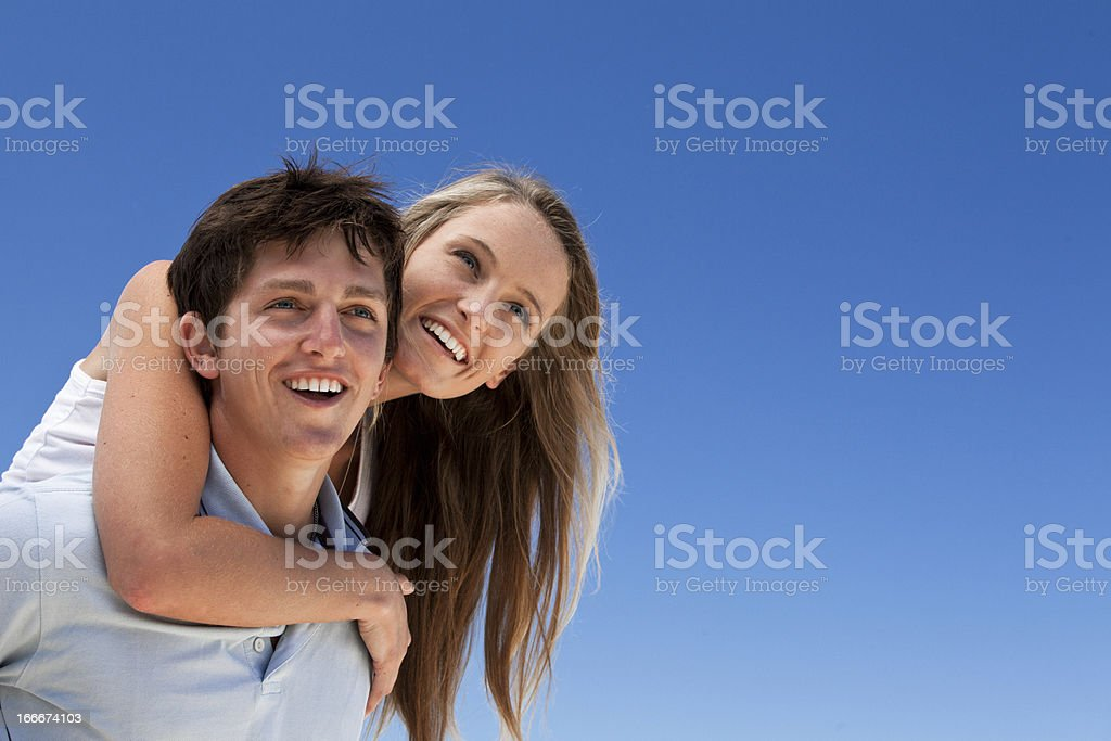 Attractive young couple against a blue sky stock photo