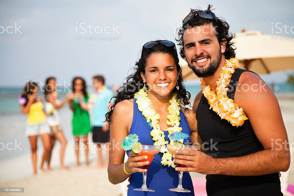 Attractive young couple at a beach party stock photo