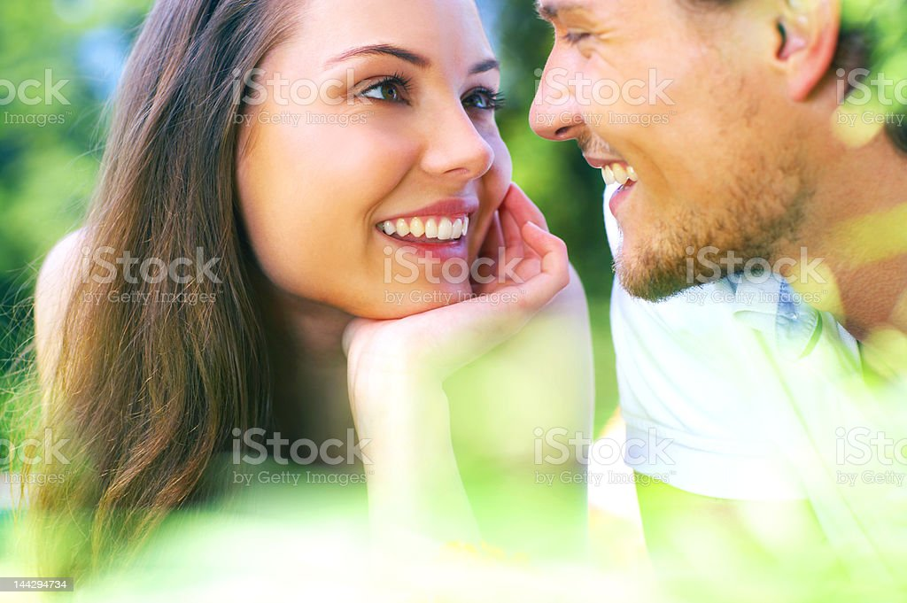 Attractive young couple gazing into each others eyes stock photo