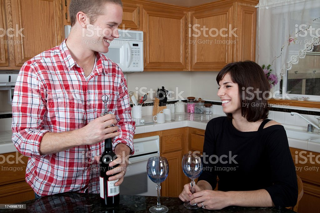 Attractive young couple having wine royalty-free stock photo