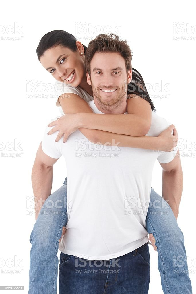 Attractive young couple in love smiling royalty-free stock photo