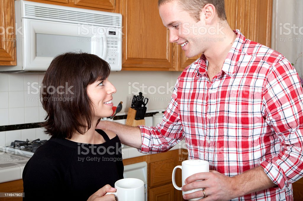 Attractive young couple in the kitchen royalty-free stock photo