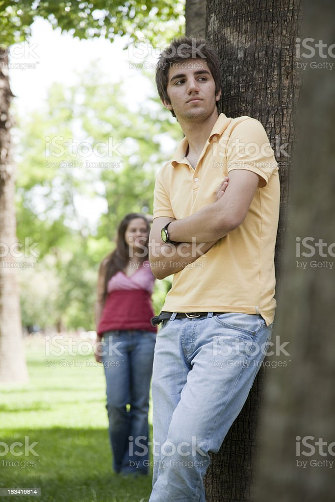 Attractive young couple in the park stock photo