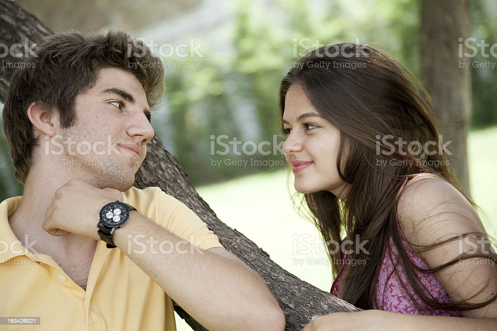 Attractive young couple in the park royalty-free stock photo