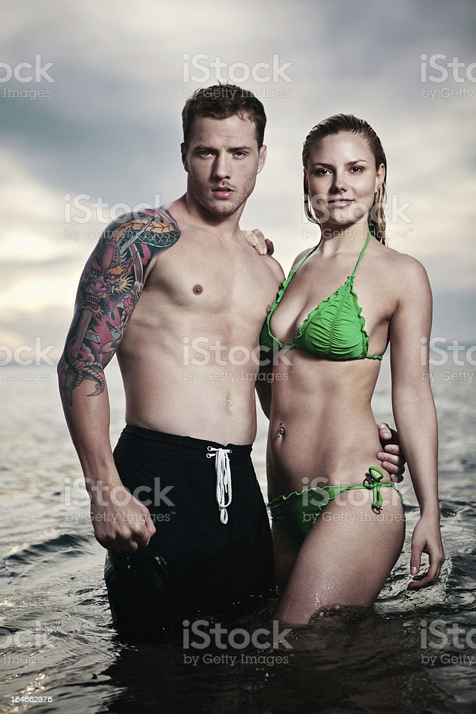 Attractive Young Couple in the Sea royalty-free stock photo
