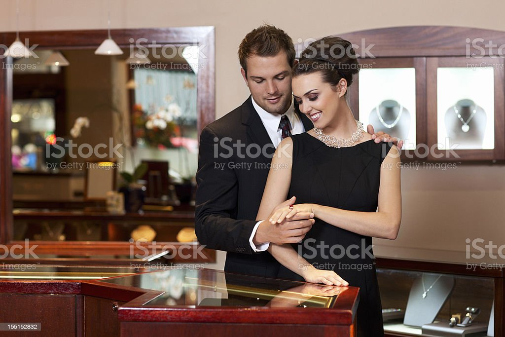 Attractive Young Couple Shopping for Rings in Jewelry Store, Copyspace stock photo