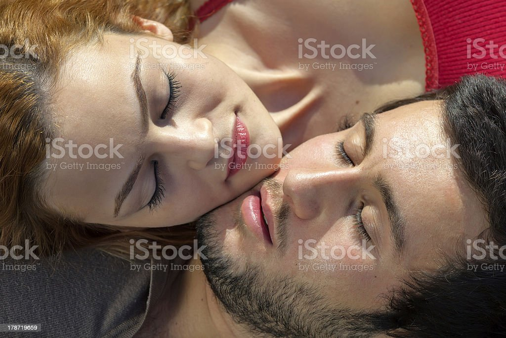 Attractive young couple sleeping royalty-free stock photo