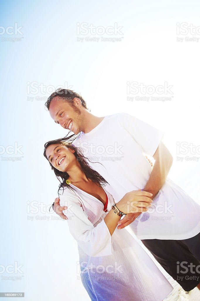 Attractive young couple standing on the beach. royalty-free stock photo