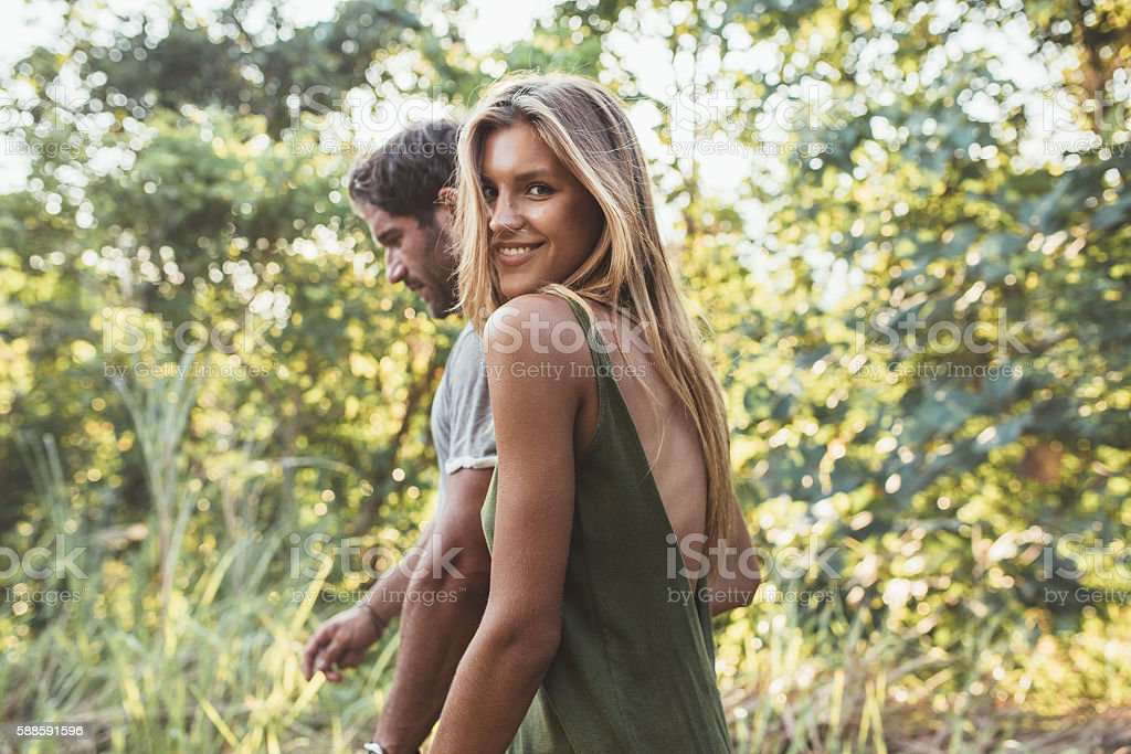 Attractive young couple walking together in countryside stock photo