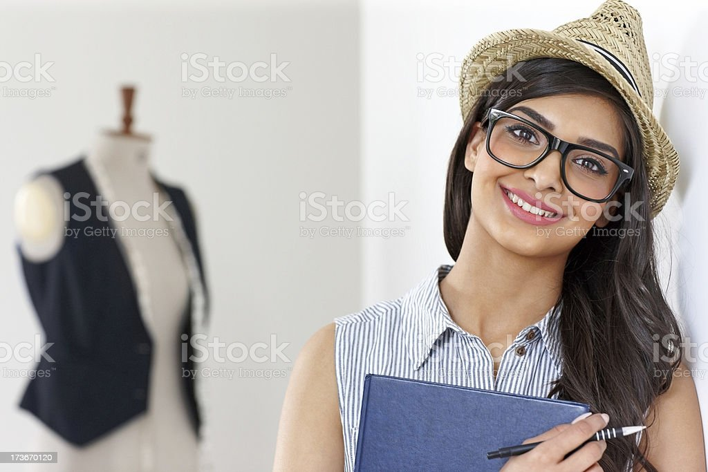Attractive young designer in fashion studio royalty-free stock photo